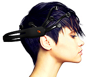 Brain Control. Profile photo of a woman wearing an Emotiv headset on her head.